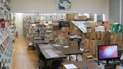 iew of the reading room and the collection room (on-the-right-books-in-boxes waiting for cataloging) March 2014